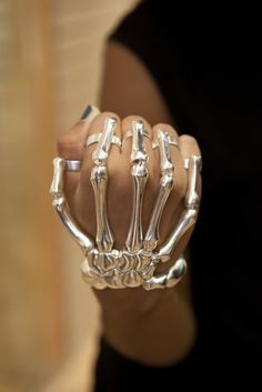 Skeleton Hand Bracelet - The skeleton ring and bracelet combo designed by Delfina Delettrez is available in silver or gold. Whatever the metal, it will make an impression on everyone who sees it (or leave one if you punch someone with it) Skeleton Hand Bracelet, Hand Bracelet With Ring, Skeleton Hands, Hand Ring, Ring Bracelet, Jewelry Bracelets, Jewlery, Skeleton Gloves, Skull Bracelet