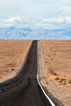 Two cars on Badwater Road in Death Valley, California