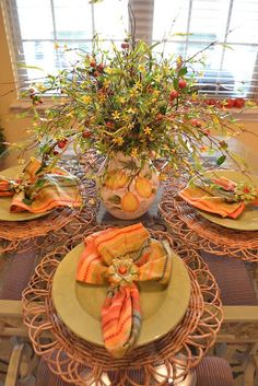 The salmon color along with the different patterns and textures make for a beautiful designed tablescape.  The only negative is the lack of table size, there is no way someone could actually use it.