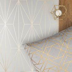 This unique geometric wallpaper will add a contemporary finish to the desired room. Using the Grey & Gold Arna Wallpaper will enhance luxury when styled with matching accessories. Gold Geometric, Wallpaper, Geo Wallpaper, Grey, Colorful Backgrounds, Grey And Gold, Feature Wall, Gold Geometric Wallpaper, Love Wallpaper