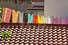 Fresh laundry hanging on a clothesline in city by Vladyslav Morozov, via Dreamstime