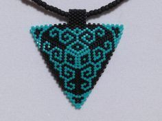 Turquoise and Black Scroll Peyote Triangle by DoubleACreations