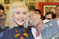 Debbie Harry and guest at Chris Stein's photo show in LA.  May 2015.  What a smile!