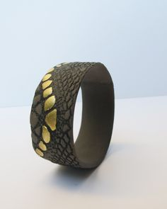 A personal favorite from my Etsy shop https://www.etsy.com/listing/247008341/black-grey-and-gold-cuff-porcelain