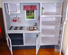 Giggleberry Creations!: Milla's Kitchen - handmade by Papa & Grandma Barbara.......  Would love to do this for brayden and ava. I would switch hinges of the oven to the bottom so it opened like a real one though a d put inside a playhouse out back....possibly hook up to actual water?
