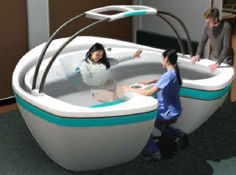 Check out this crazy freaking birthing tub! Wowsa! Looks like something from a Star Wars movie...