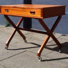 1960s danish teak 'Sewing table' with wheel-mounted X-legs: http://retro-design.dk/butik/sybord-entre-moebel-af-teak-dansk-design-1960erne/