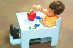 This play table and seat help the child achieve proper positioning, develop core strength, and interact with the toys in front of him.