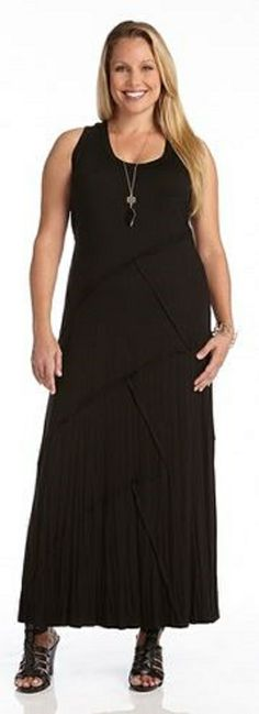 This casual cool maxi dress from Karen Kane will be an instant hit in your wardrobe. Its body consists of basic black jersey with not so basic reverse seam detail for a uniquely stylish touch. Wear on the weekend with your favorite sandals and a denim vest or jacket. #Plus_Size #Maxi_Dresses #Karen_Kane