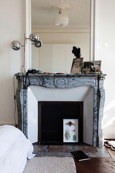 Gerardo Ruiz-Musi's apartment in Paris with a #Pompadour #fireplace in #marble #19thcentury #antique #frenchantiques #frenchstyle #interiordecoration #decor #interior #design