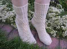 I designed these socks because I love the German twisted stitches. I found two stitch patterns that worked well together in Überlieferte Strickmuster By Maria Erlbacher. I twined one of these cables around the leg to meet and become the second cable on the foot. The name Meander came from its definition of an ornamental pattern of intertwining lines. It is a fun pattern to work but pay attention.