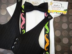 Mustache Birthday Party Shirt with Neon Mustache Suspenders and Black Bow Tie, Mustache Party Onesie, Mustache Bow Tie and Suspender Onesie. $29.00, via Etsy.