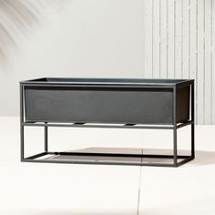 Shop Kronos Low Planter. Industrial planter gives rise to greens in matte carbon powdercoat. Nested within sculptural iron frame, galvanized steel boxes remove for easy planting and watering. Arrange together to create a hi/lo effect, indoors or out. kronos planters is a CB2 exclusive.