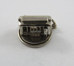 Mechanical Streetcar that Revolves Around Sterling Silver Charm or Pendant. This charm weighs grams and it measures 18 mm by 15 mm. A great addition to your charm bracelet. This is the actual charm you will receive.