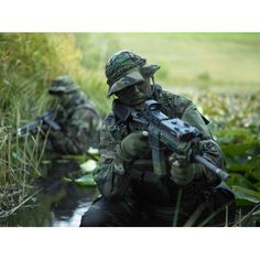 US Navy SEALs cross through a stream during combat operations Canvas Art - Tom WeberStocktrek Images (33 x 25)