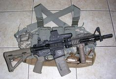 Cool SBR (short barreled rifle) with foliage green magpul furniture (vertical foregrip by Tango Down).