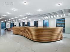 Introduced in reception, zinc inlays in the terrazzo floor conform to the building's 5-foot module