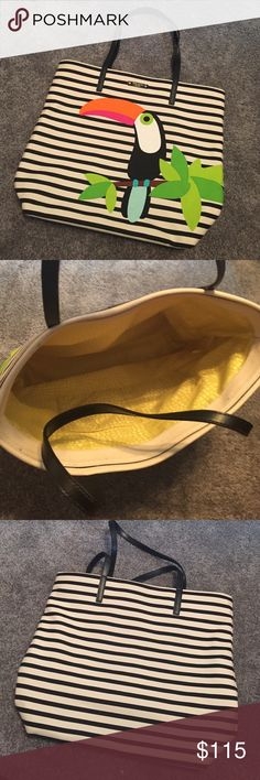 Kate Spade Toucan Canvas Tote Gently used tote, still in great condition! There is a small smudge at the bottom of bag as pictured. Inside is a yellow/green liner with two pockets. kate spade Bags Totes