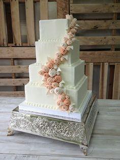 Buttercream wedding cake, peach and blush flowers, elegant wedding cakes