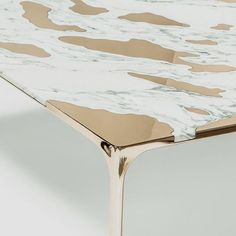 Chilean studio GT2P have created this unusual and stunning coffee table where islands of bronze rest on a marble base