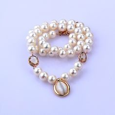 7.5-9.5 mm White Pearl Necklace Golden Shell Ring This beautiful with golden shell ring necklace falls luxuriously around your neckline for a more formal look.