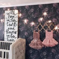 Cute girls nursery interior with dark floral removable wallpaper