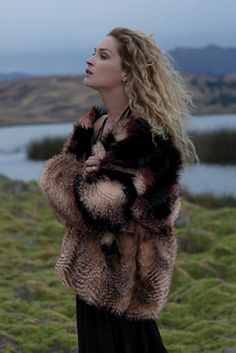 Womens SCARLET FAUX FUR JACKET by Free PeopleCozy up in this gorgeous heavyweight faux fur jacket with an eye-catching multi-color design.