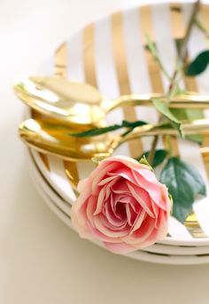 Gold striped crockery and gold plated cutlery - looks so beautiful with a single rose