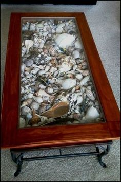 Bring the beach vibe to your outdoor area by making a seashell coffee table!