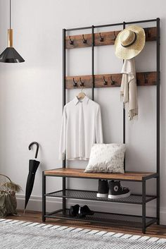 Keeping your entryway and halls clean and organized can feel like a never-ending process, but a handy hall tree can help. Complete with a coat rack, storage, and sometimes even a bench, here are the best hall trees we're loving. Entryway Hall Tree, Entryway Storage, Entryway Decor, Hall Storage Ideas, Entryway Furniture, Modern Hall Trees, Rustic Home Interiors, Industrial Interiors, Hotel Interiors