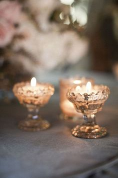 Nothing sets a warm holiday ambiance like candlelight. Mercury glass candlesticks have a nostalgic charm and cast a warm glow. Bougie Candle, Chandeliers, Candle Picture, Winter Wedding Inspiration, Wedding Ideas, Grey Skies, Candle Lanterns, Votive Candles, Mercury Glass