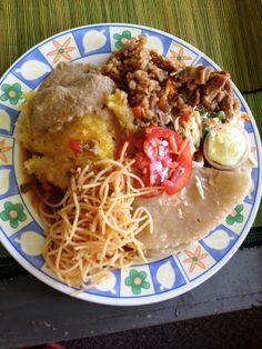 Seriously, you can't afford to miss out on home made food when you come to Uganda...so...make it happen.  This plate has millet (kalo), matooke, beef stew some salads and spaghetti