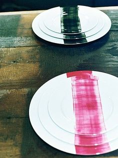 French designer Mathilde Labrouche takes advantage of the tactile appeal of brush strokes with her line of painted plates. Design firm: Coté Pierre *Great example of DIY-turned-business! At first she made these at home from scratch; now they're finished to her specifications in Limoges. Love!