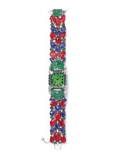 Cartier Tutti Frutti platinum bracelet watch from 1929 set with diamonds, emeralds, sapphires and rubies. From the @Cartier Collection