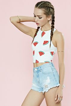 A sleeveless crop top crafted from stretch knit with an allover watermelon print.