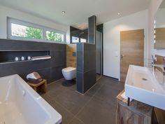 Musterhaus Falkenberg modern bathroom ambience with wood and avantgarde mixers from hansgrohe. Toilette Design, White Doors, Room Doors, Living Room Modern, Model Homes, Bathroom Renovations, Bathroom Inspiration, Cheap Home Decor, Modern Bathroom