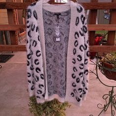 Beautiful Cardigan Beautiful white fuzzy cardigan with black horse shoe designs. Brand new never worn. Given as a gift. Apt. 9 Sweaters Cardigans