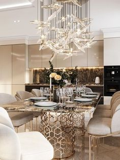An amazing and mesmerizing design by Domoff Interirors! #designinspiration #designideas #interiordesign #interiorinspirations #designgoals #diningroom #chandelier #diningchair #rug Modern Classic Bedroom, Dining Chairs, Dining Room, Chandelier, Rug, Design Inspiration, Ceiling Lights, Interiors, Contemporary