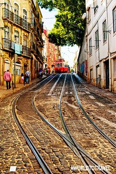 Alfama narrow streets cutted by tramway rails, Lisbon , Portugal