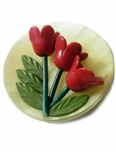Vintage red tulip celluloid button | Date Unknown