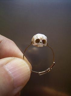 The most beautifully unique jewelry I've seen. carved pearl skull ring - S.NAKABA