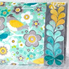 Shannon Fabrics Fabric Used: Body: Crazy for Daisies by ADORNit; Band: Various Kozy Cuddle Collection solids Download the free feather applique pattern here: http://www.allpeoplequilt.com/millionpillowcases/freepatterns/Pillowcase-37.pdf