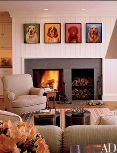 Neil Winokur portraits of the owners' past and present dogs hang above the fireplace in the sitting area adjacent to the kitchen. Cowtan & Tout sofa fabric. Rug, Elizabeth Eakins | archdigest.com