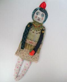 Mädchen mit Apfel...ist auf Seidde sie gemalt aufgeklebt auf Pappe. Zum aufhängen. Der Apfel ist aus Plastik. Die Hände sind beweglich...