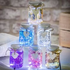 Buy Mini Metallic LED Firefly Jars from The Letteroom: These Speckled effect Mini Jars with LED Lights are perfect for lighting garden parties or to create a pretty light in a window. Crafts With Glass Jars, Jar Crafts, Bottle Crafts, Bottle Fairy Lights, Vases En Verre Transparent, Fireflies In A Jar, Jar Art, Led, Wooden Hearts