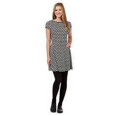 From Red Herring, this simple yet stylish dress is perfect for creating effortlessly chic daytime looks. In black with a contrasting daisy print, this wardrobe essential features a flattering form fitting top with a skater style skirt, making it ideal for teaming with tights and a pair of fleece lined ankle boots for a classic layered-effect outfit.