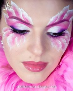This could be a sample of the flowers' makeup. The colors will correspond with the colors of the costume so that everything will match. By painting around the eyes, it will help to camouflage them to keep the illusion that they acting as flowers.