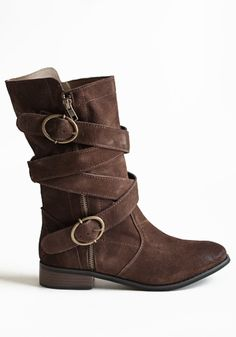 Rich brown biker boots in distressed suede with buckles and straps.