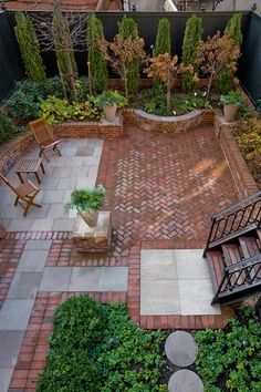 Traditional Patio with exterior brick floors, Pathway, Raised beds, Fence