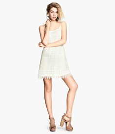 Short dress in lace with narrow adjustable shoulder straps and an elasticated seam at the waistline. I tried this dress on, but it was maybe too short for me.